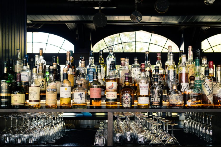 An image of a well stocked bar full of spirits